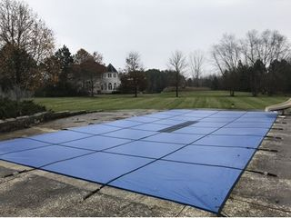 Water Warden Solid Safety Pool Cover for In Ground Pools w Center Drain Panel