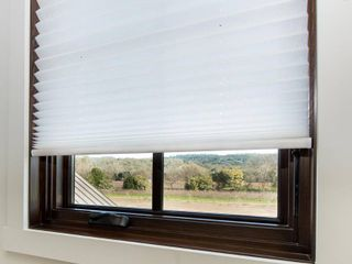 Easy lift Trim at Home Cordless Pleated light Filtering Fabric Shade White  48 in x 64 in   Fits windows 31  48
