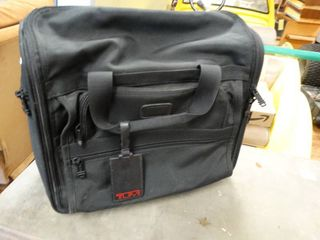 Tumi carry on bag w  handle   wheels