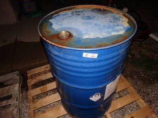 55 gallon barrel partial full of kerosene