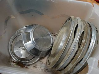 lot of old hubcaps