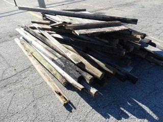 large lot of wood fence lumber
