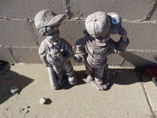 Cement boy statues