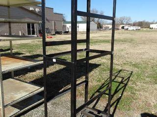 Black metal rack on wheels  34  x 17  x 78  tall