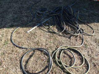 lot of assorted garden hoses