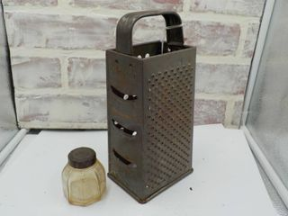 antique cheese grader and ink bottle