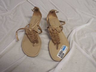A pair of express sandle s size 8