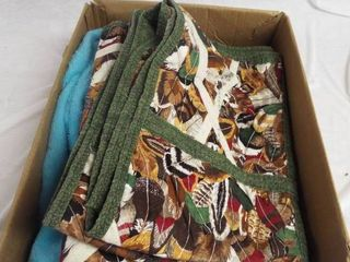 lot with a sheet and a couple small blankets