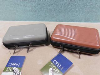 2 Open story hardside mini cases  one is green  other is red 7 in l X 4 1 4 in W X 2 1 2 in H