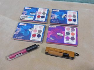 lot of 4 Coloured raine eyeshadow palettes  3 are lovelies  other is berry cute  one e l f  liquid matte berry sorbet lipstick  10 fl oz  and one e l f  16hr camo concealer  0 203 fl oz