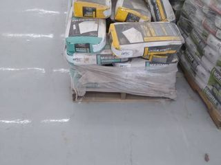 pallet of underlayment and mud bed mix