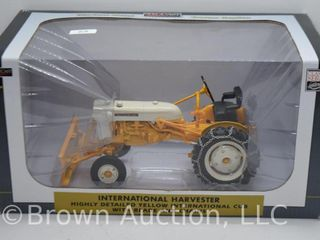 International Harvester Cub tractor with blade and chains  1 16 scale die cast