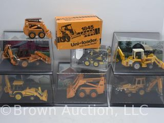assortment of die cast Skid loaders and Back hoes