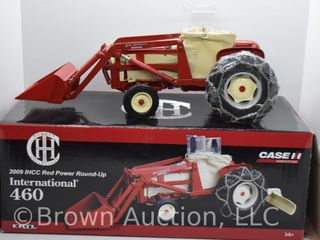International 460 die cast tractor with McCormick front end loader  rear blade  tire chains and