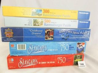 Puzzles  5  one new  two Ravensburger
