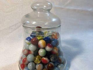 Glass Jar with Marbles location Shelf 5