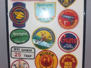 Framed lot of 16 Gun Firearms Patches