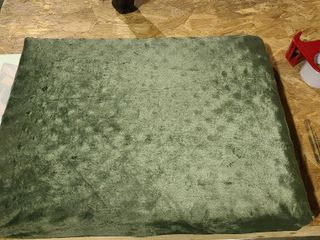 26 x 20 green dog bed   has small opening on bottom