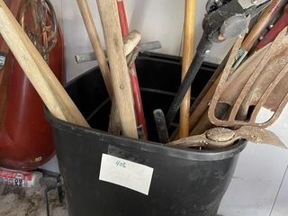 large Trash Can Full of Hand Yard Tools