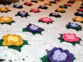 Colorful Crocheted Afghan with Three Dimensional Roses  Pink Blue Yellow and Purple  Measures 61  x 49
