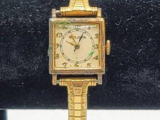Vintage Women s Bulova Watch 10K GF Top Caps  Engraved with date 5 10 44   Speidel stretch wrist band