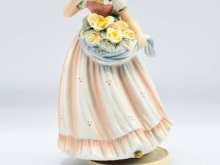 Berman   Anderson Music Box Figurine of Young Girl with Yellow Roses