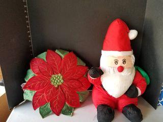 Stuffed santa and pillow