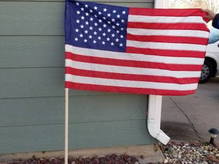 US flag  pole and 2 additional flags
