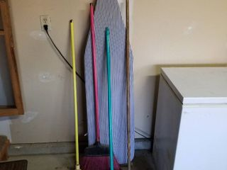 Ironing board  brooms and mops