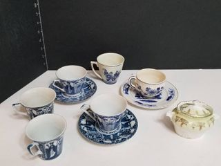 Tea cups and saucers with sugar bowl