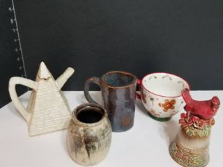 Redbird bell and assorted pottery pieces