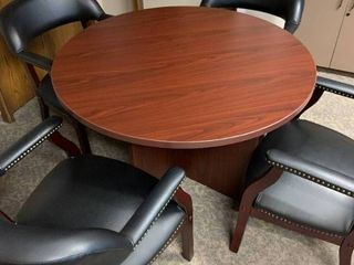 Round conference table with leather chairs