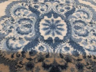 blue and white flower pattern rug