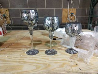 Three Glass Goblets with candles