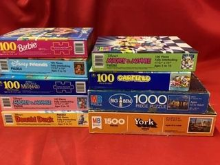 BOX OF PUZZlES  MOSTlY NEW