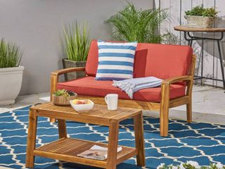 Grenada Outdoor 2 piece Acacia Wood loveseat and Coffee Table Set with Cushions by Christopher Knight Home  Retail 449 99