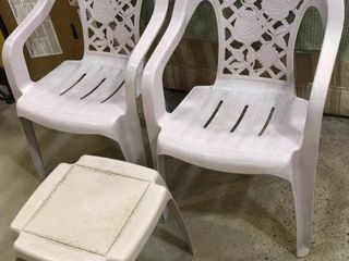 2  Plastic Deck Chairs   Side Table