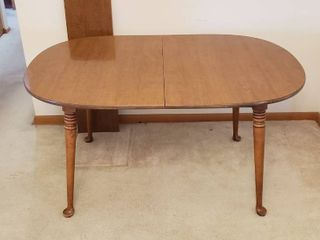 Maple Wood Oval Dining Table w Formica Top   One leaf  12 in      56 x 38 x 29 in  tall