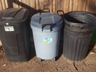4 Trash Cans   2 with lids   Wheels and 2 without