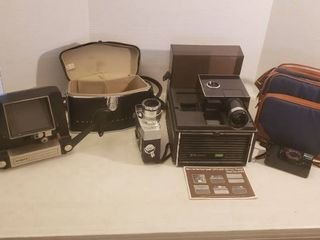 Vintage Argus 8mm Editor   model 767  Bell   Howell Zoomatic 8mm Camera  Bell   Howell Slide Projector  Canon 38mm Camera and Camera Bag   all electronics power on