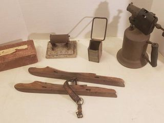 Vintage Items  Brass Brazing Torch  Wood Metal Ice Skates  Metal Well Baler piece  Solar Electric Cylinder Heater  missing cord  and Brick from 1st Christian Church of El Dorado  Ks