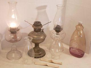 3 Oil lamps  1 Aladdin   Burner Bent  2 Extra Chimneys  2 Wicks and lamp Oil
