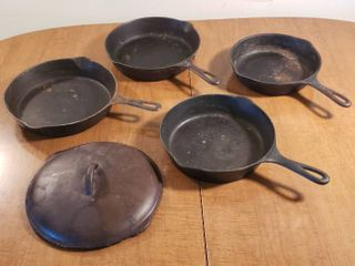 4 Cast Iron Skillets   Wagner  6    8  2 Fire Ring Bottoms and an 8 B lid