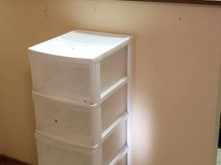 Plastic 5 Drawer Storage Chest on Casters  13 x 16 x 52 in  tall  and 5 Rubber Covered Wire Cabinet Shelves