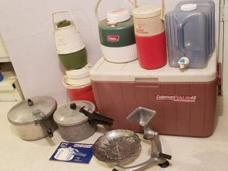 2 Pressure Cookers  Steamer Strainer  Coleman Cooler  and Water Jugs