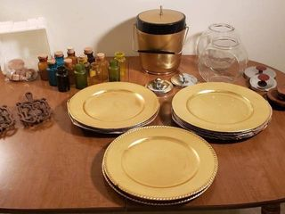 Vintage Ice Bucket  Colored Glass Spice Jars  Gold Plastic Chargers  2 Cast Iron Trivets and 2 Clear Glass Canisters   lids