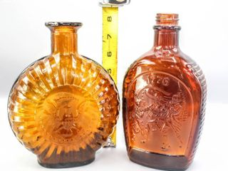 2  Amber Glass Bottles 1776 log Cabin Syrup and Star and Eagle Crest Both Approximately 11  Tall