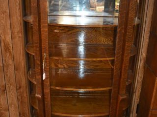 Antique curved glass china cabinet  mirror backed top shelf