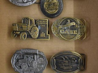 8  Case tractor belt buckles and  1  key chain
