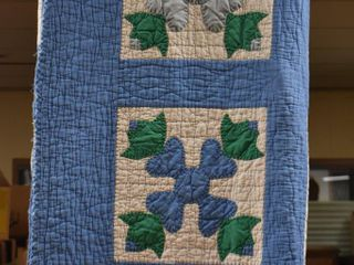 Hand stitched quilt  blues and green